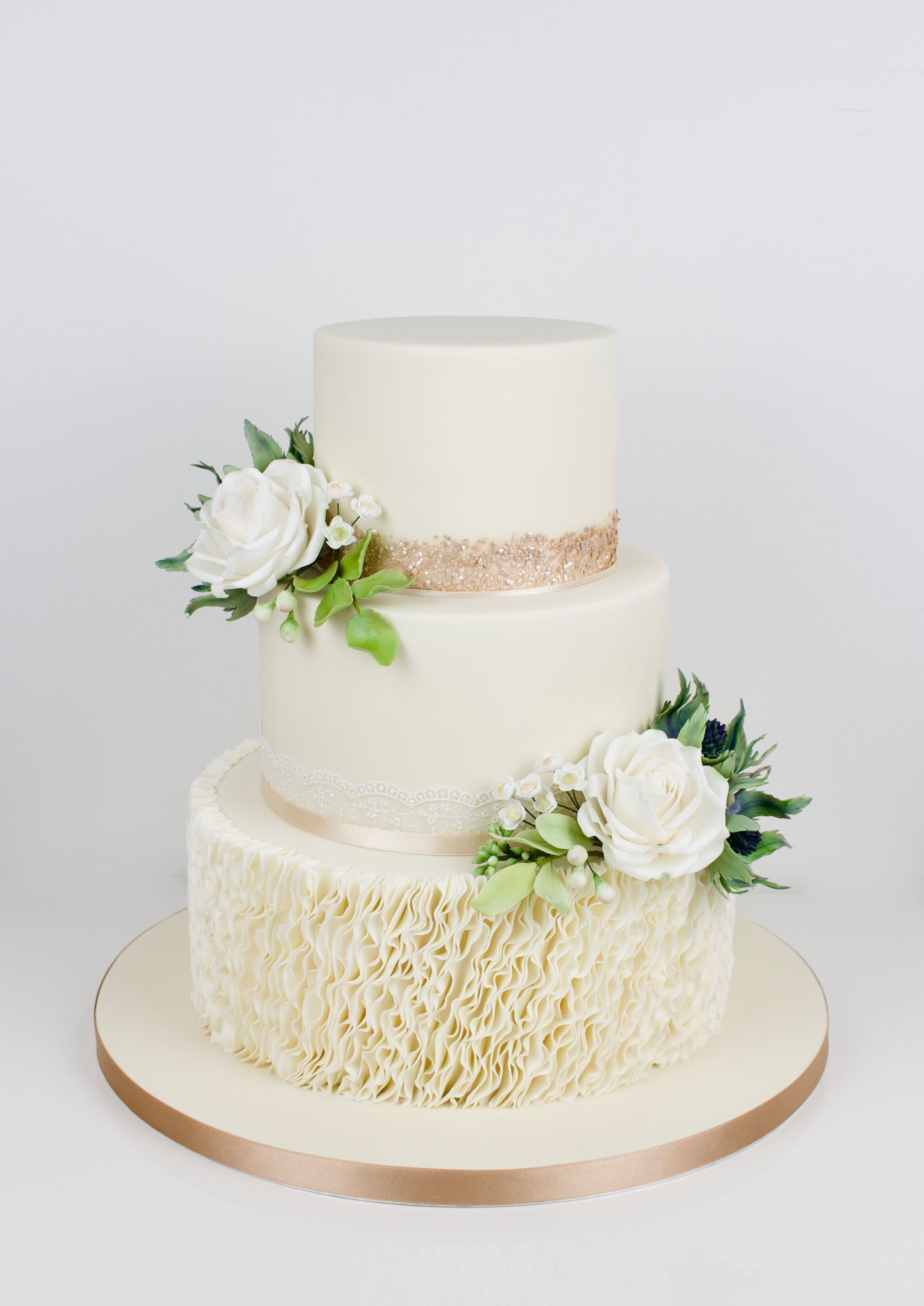 3 tiers icing ruffles with lace, glitter and handmade sugar white roses and thistles