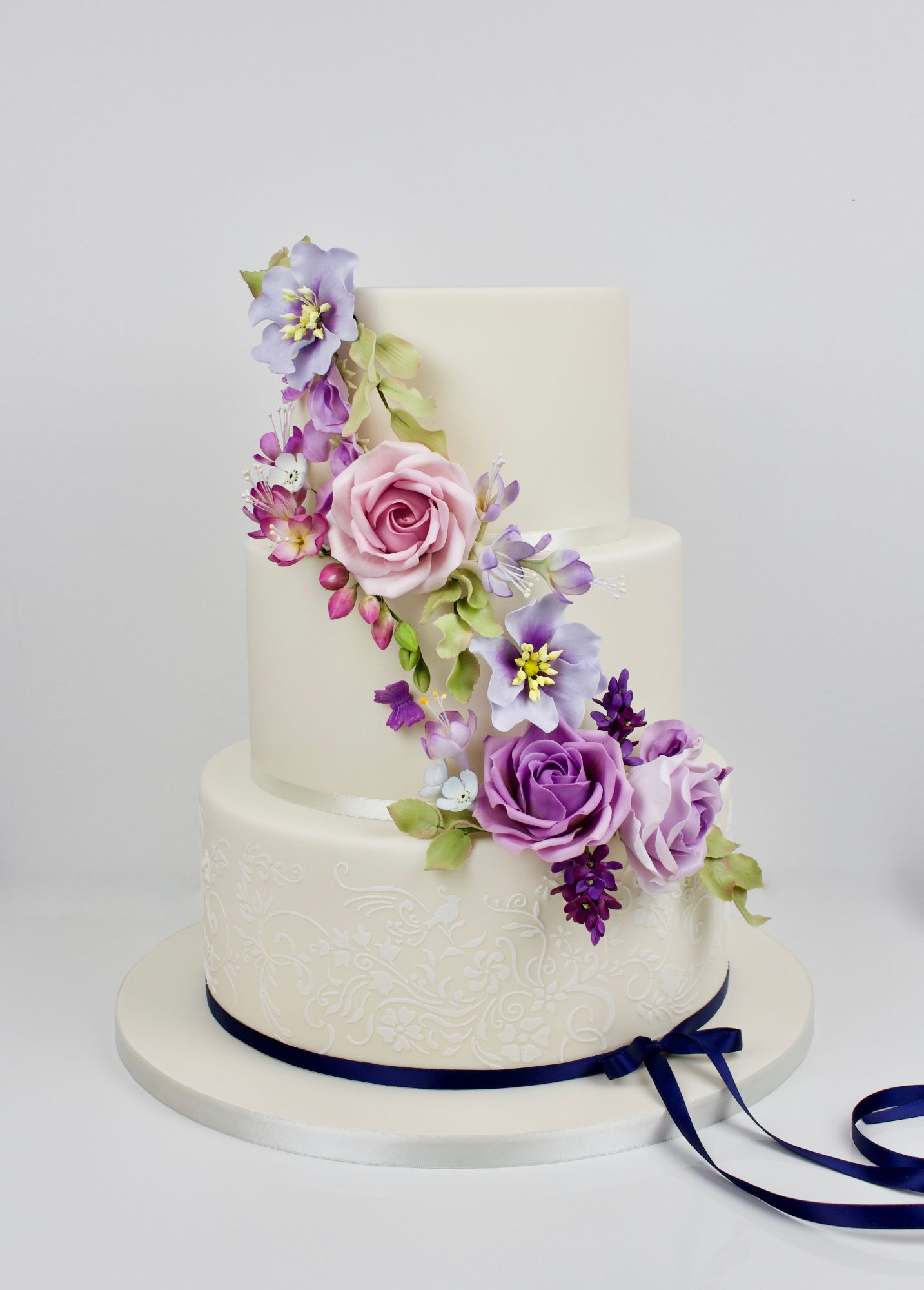 Purples and pinks dugar garden flowers with stenilled and navy ribbon