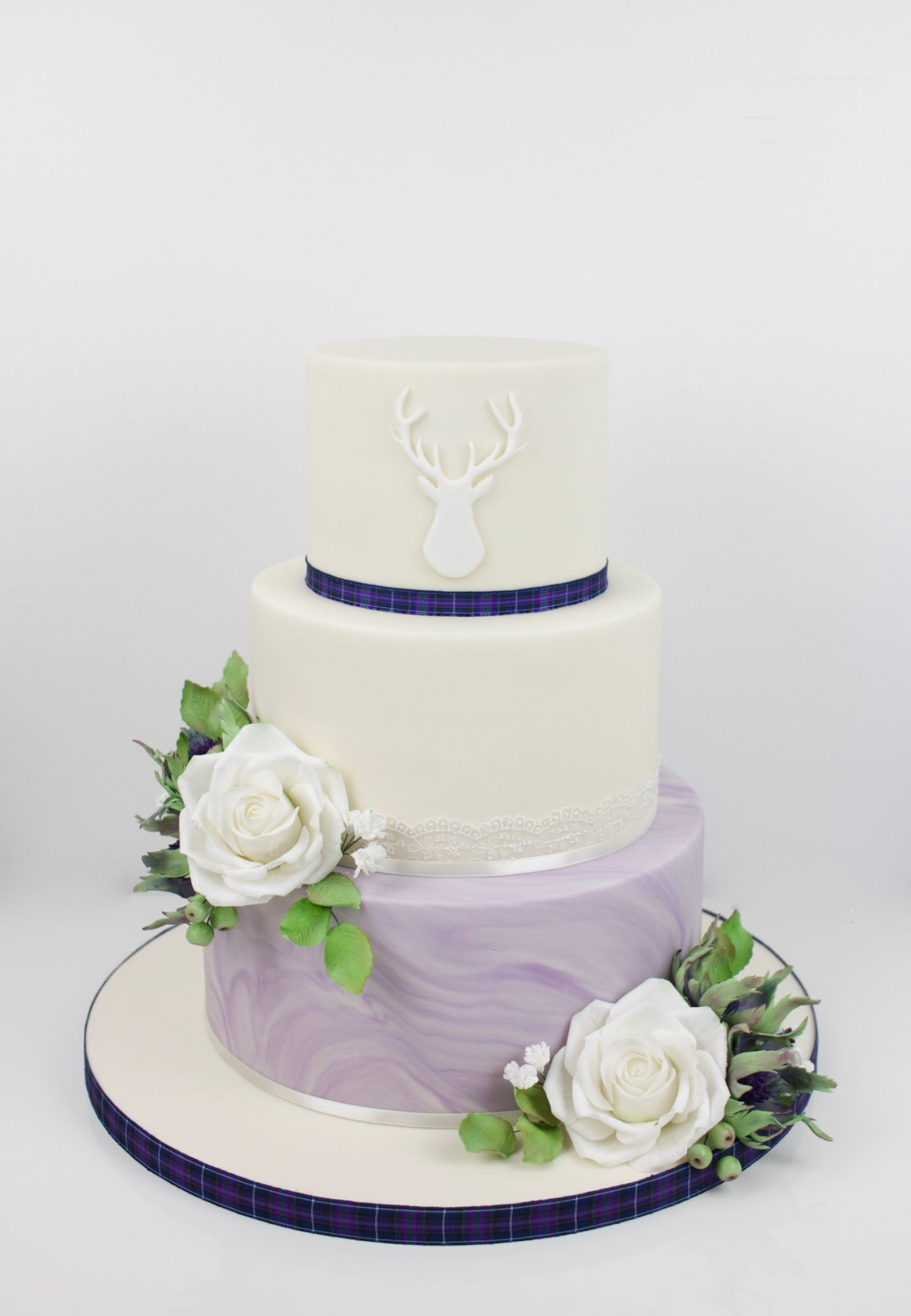 Purple marble tier with scothish stag, roses amd thisltes with tartan ribbon