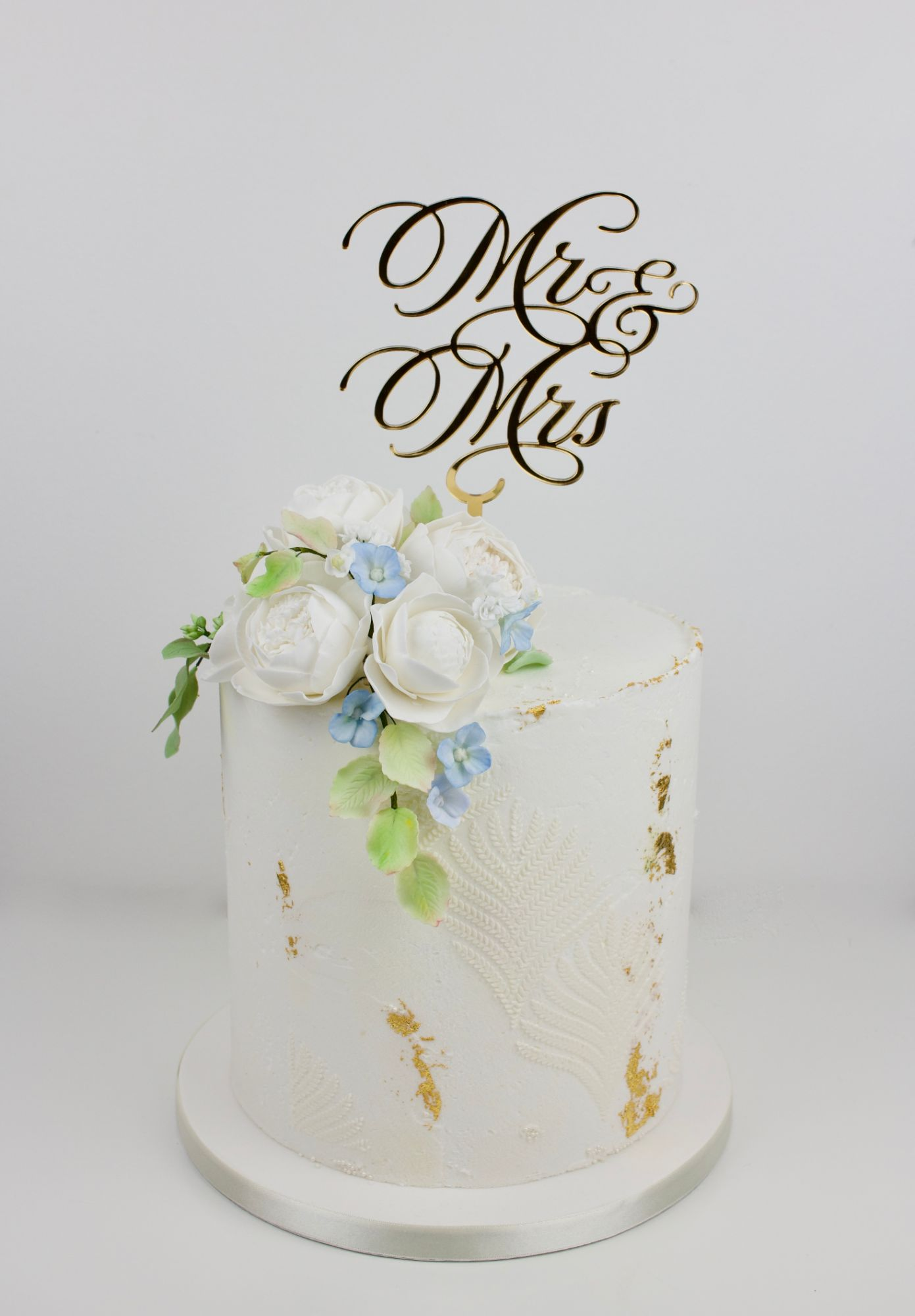 Double barrel buttercream modern design with harvest stencil and gold topper..
