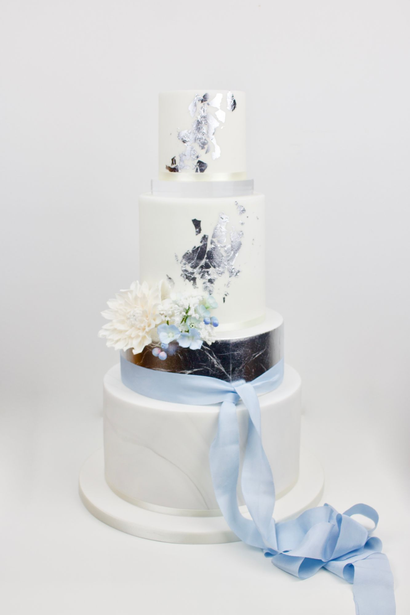 4 tier with clear stand silver leaf and cornflower blue silk ribbon