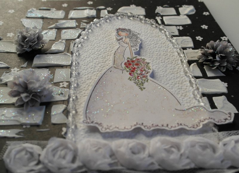 bride in arched doorway beads