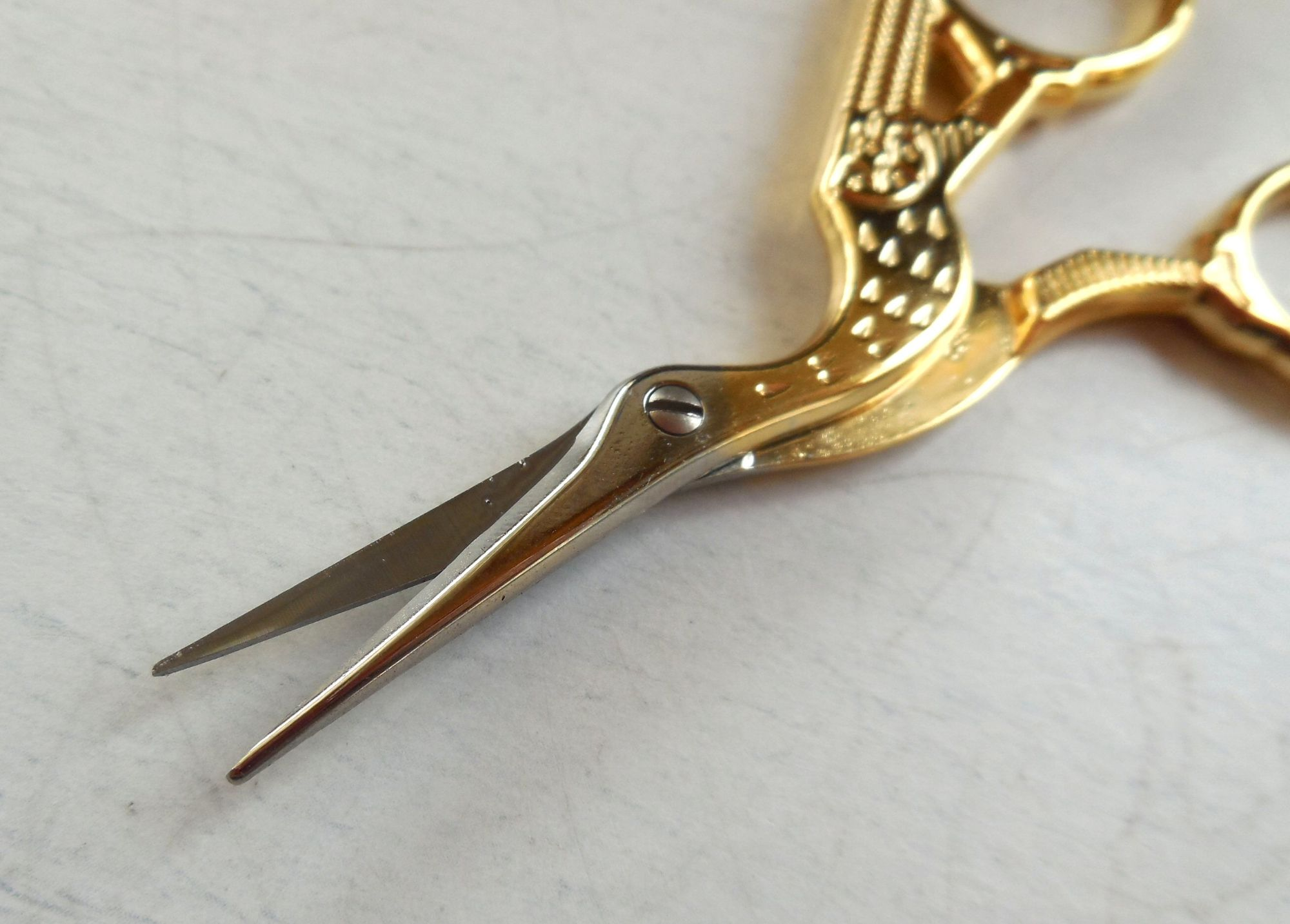 Stork scissors blade