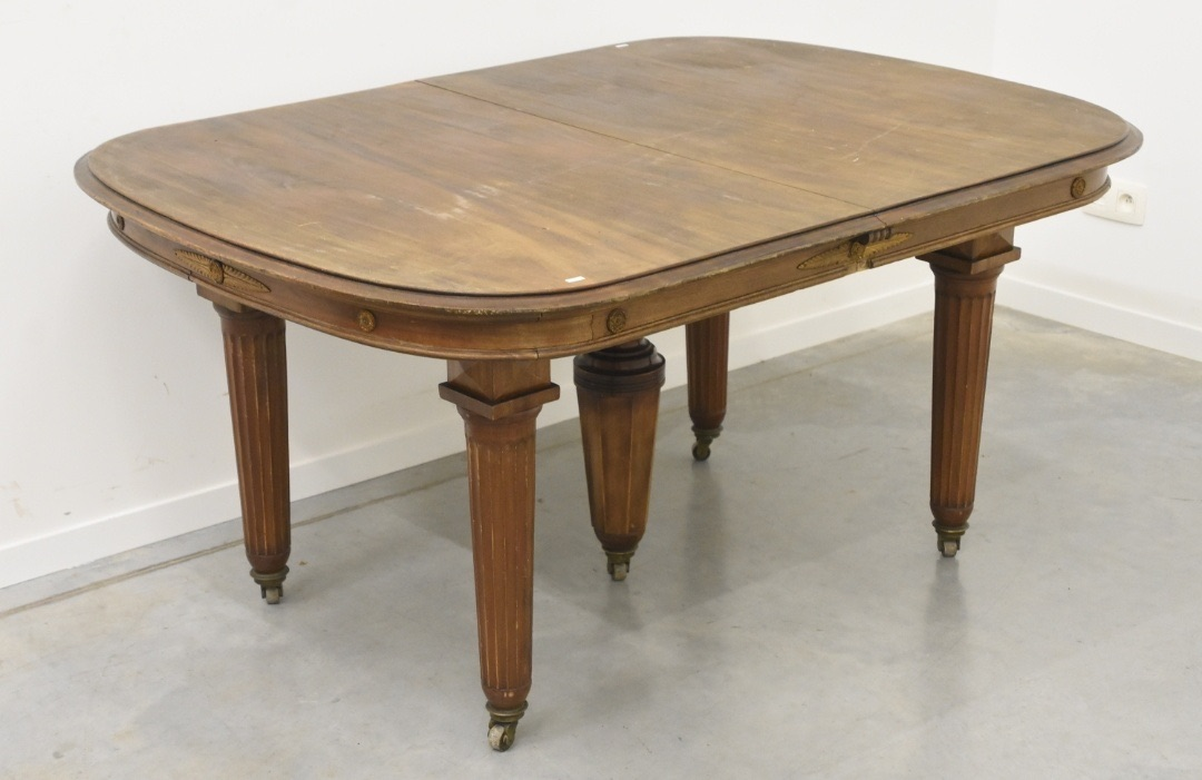 French Art Deco dining table with brass details