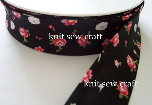 black multicoloured flower pattern cotton bias binding 25mm x 25mtr