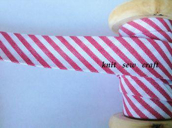 red and white spiral stripe bias 18mm candy cane print 1 metre byetsa
