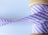 lilac and white spiral stripe bias 18mm candy cane pattern fabric 1m