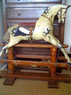Sold - An antique rocking horse by Woodrow in original unrestored condition.