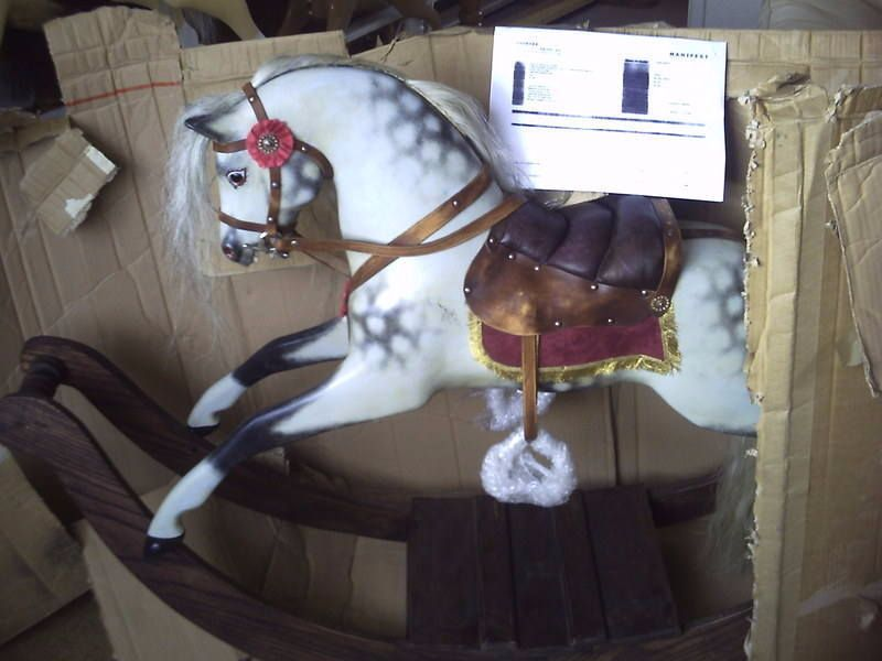 Pretty little bow rocking horse that starred in a movie.