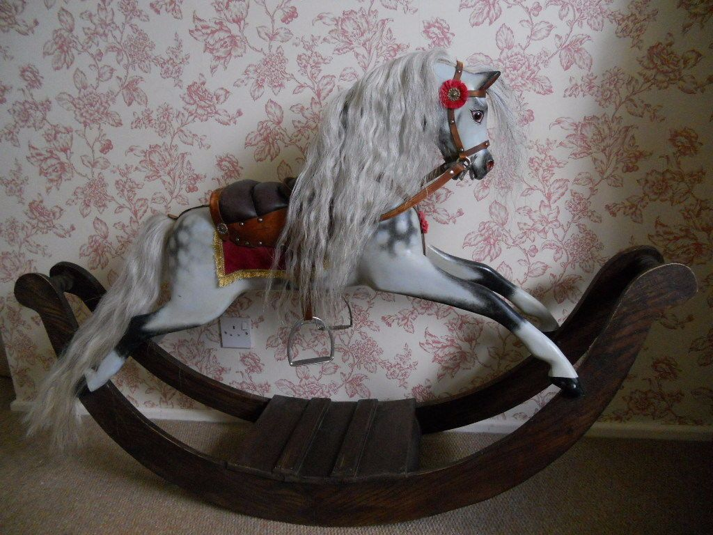 bow rocking horse woman in black movie