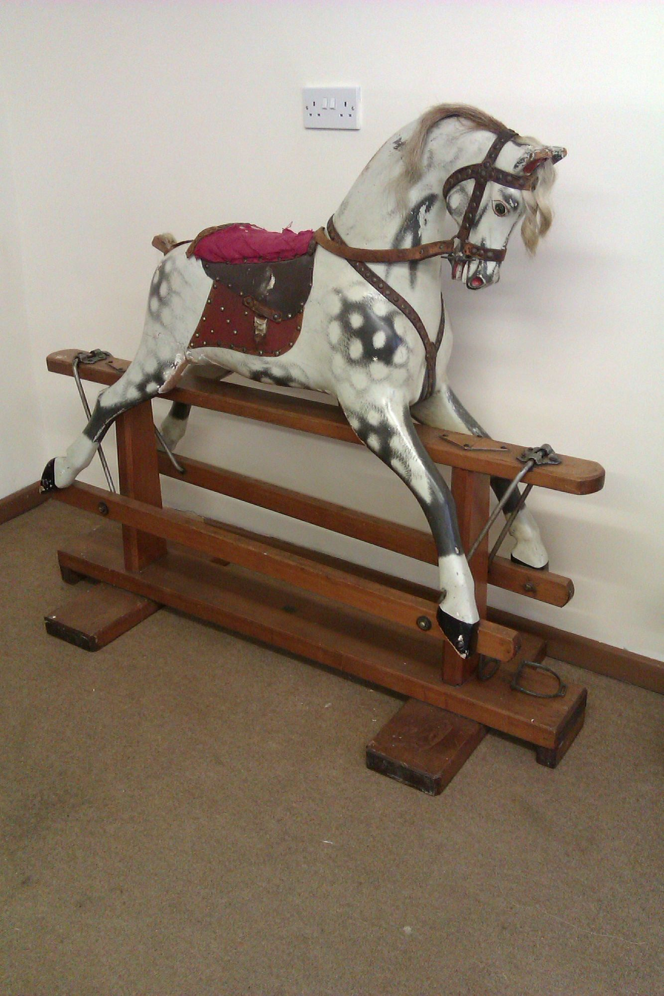 Baby Carriages rocking horse similar to Collinsons but with nicer carving