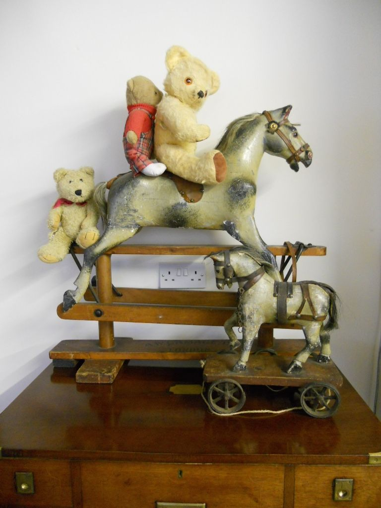 Sold - A tiny size Antique rocking horse in original condition.