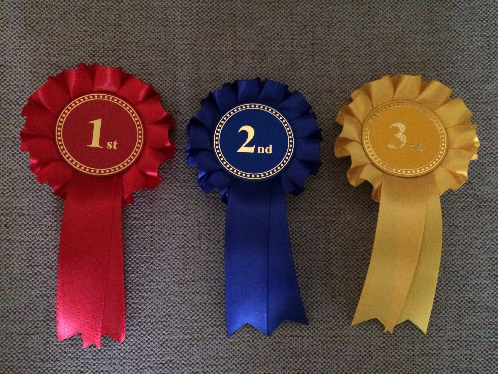 Rocking Horse Rosettes in a set of three, first, second & third prizes! in red, blue & yellow.