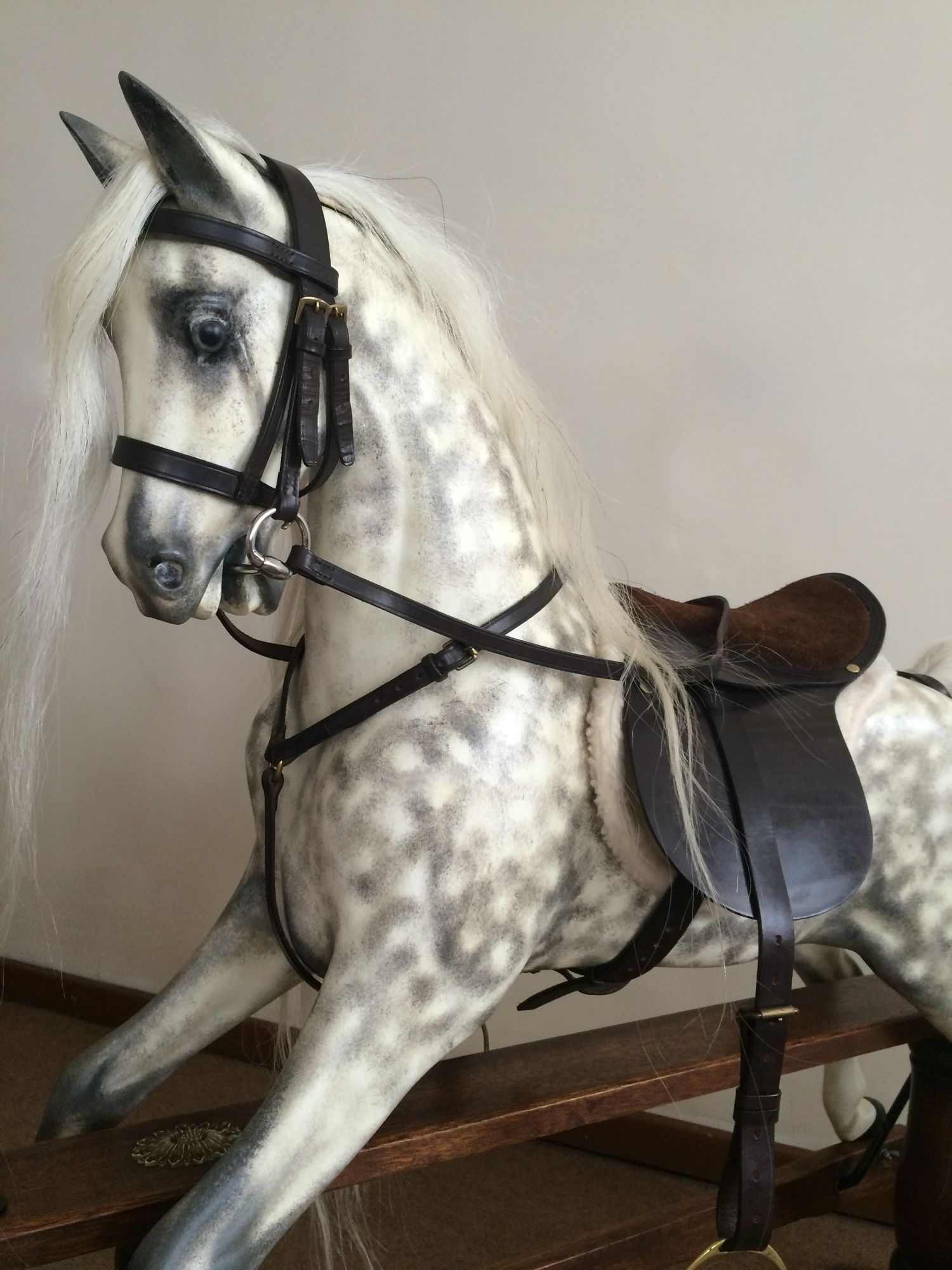 A Haddon type rocking horse moulded from an F H Ayres Victorian model of horse, restored in a natural realistic dapple grey style.