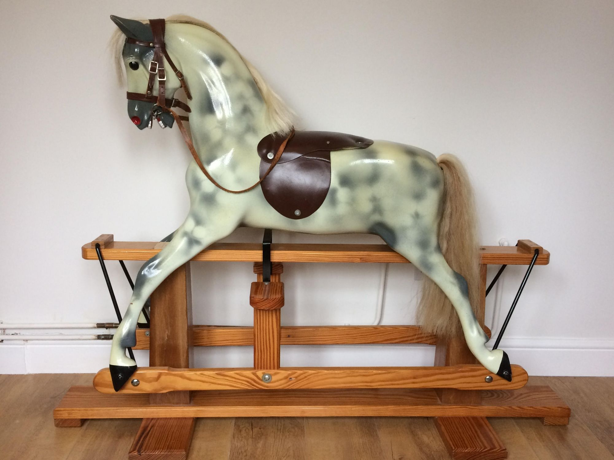 A Haddon rocking horse moulded from an F H Ayres Victorian model of horse in its original condition.