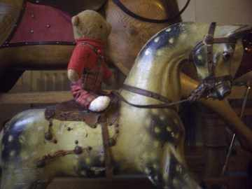Antique rocking horse by G J Lines with old teddy.