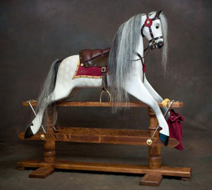 rivelin2 rocking horse with a dark finish stand