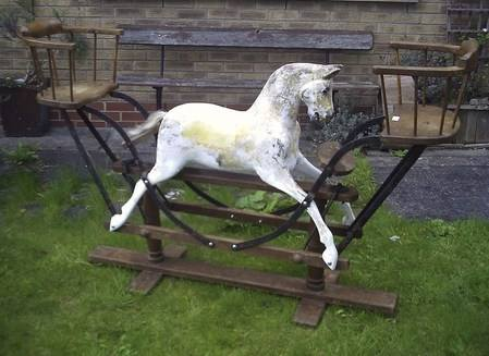 Antique Lines Bros nursery rocking horse with end seats.