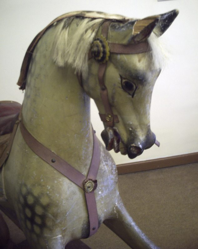 This Antique rocking horse by Frederick Henry Ayres ( F H Ayres) has her original dapples intact.