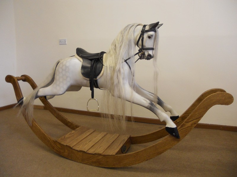 Traditional dapple grey rocking horse on a bow rocker.