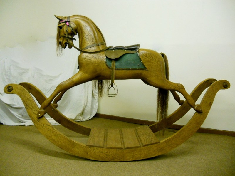 Wood Stevenson Brothers Oak rocking horse on bow rocker