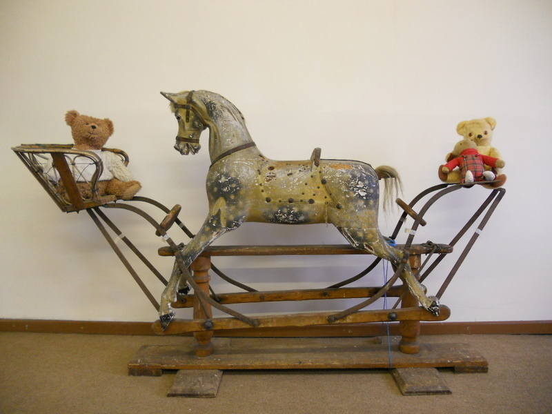 An antique nursery rocking horse by G J Lines, with end seats.