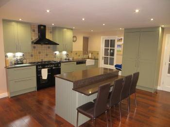 Island Breakfast Bar Kitchen. Painted Solid Wood Doors In French Grey,  Quartz Worktop