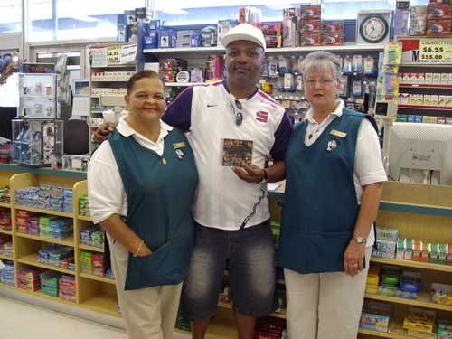 Clinark with the Mrs Outerbridge and fellow staff Collectors Hill Pharmacy