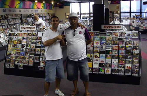 Clinark with Michael Mello Manager of MUSIC WORLD Bermuda major Record Shop