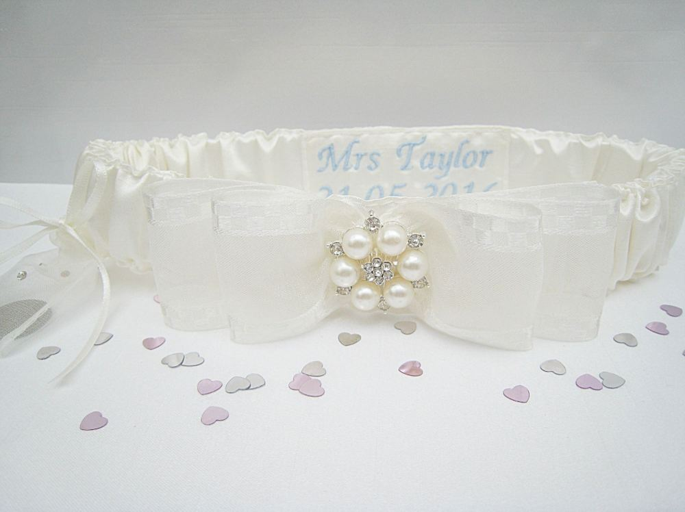 Ivory Wedding Garter Personalised, Silver Sixpence Stitched To The Side