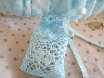 Blue Bridal Garter With a sixpence bag stitched onto the side.