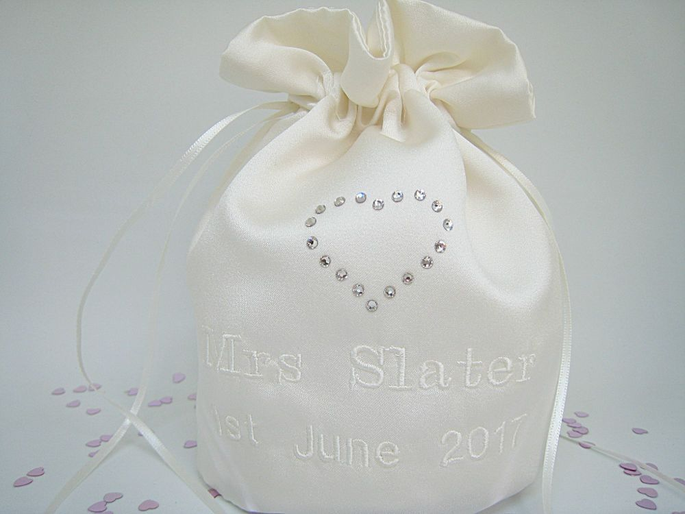 A Satin Dolly Bag With Designer Love Heart On The Front.