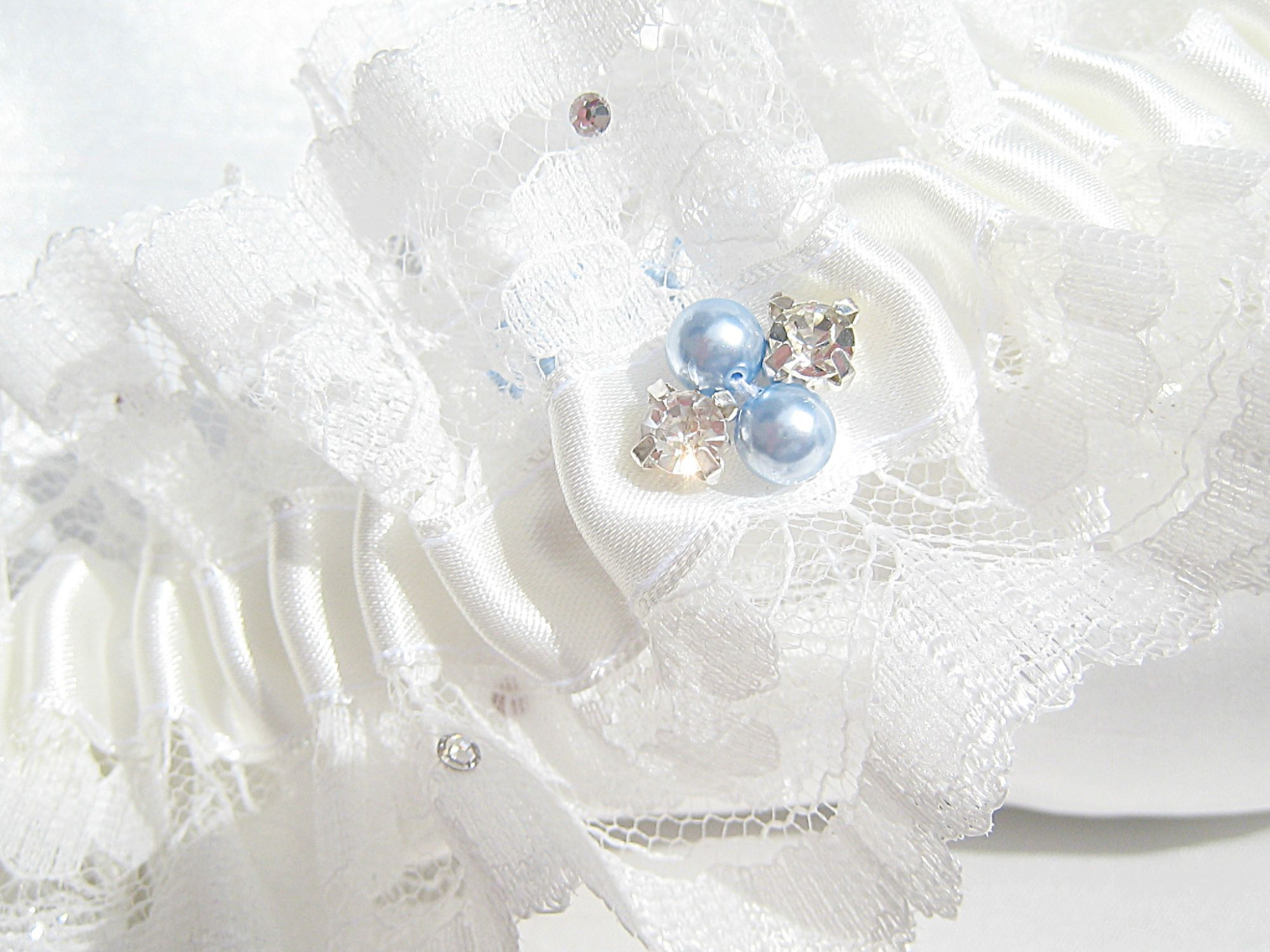 Blue Wedding Garters, Personalised On The Inside With The Brides New Name & Wedding Date.