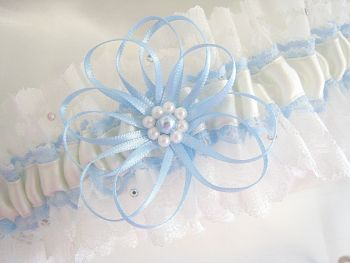 Wedding garter with blue ribbons and Swarovski pearls.
