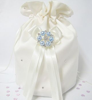 Satin dolly bag which has blue pearls on it and crystals.