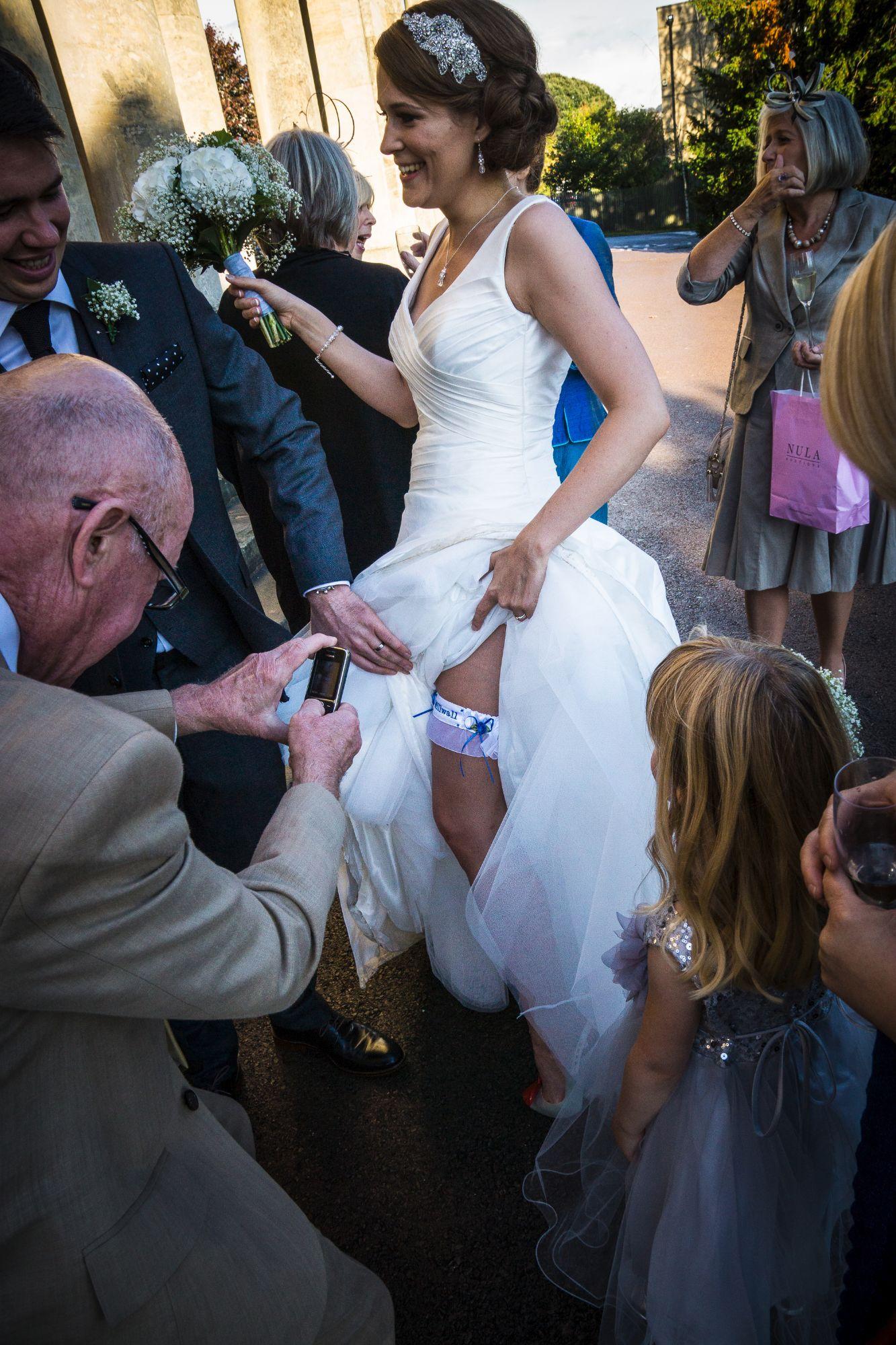 Wedding Garter Photo's Being Taken On The Brides Wedding Day.