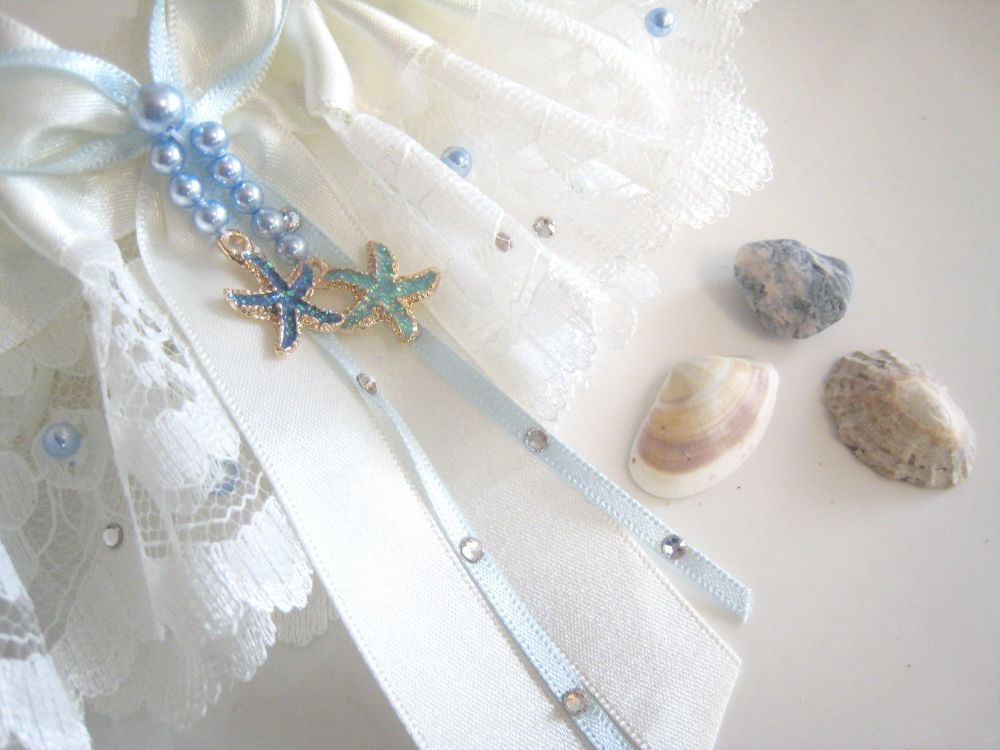 Starfish charms stitched onto a wedding garter, for a beach wedding.