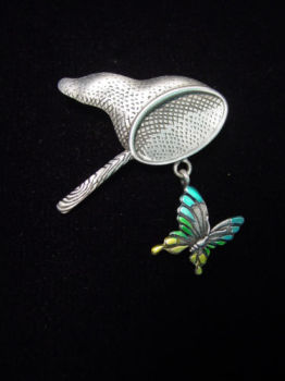 BUTTERFLY AND NET BROOCH