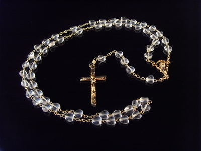 Glass rosary beads with clear hearts and gold crucifix