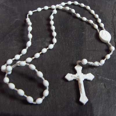 White plastic prison issue rosary beads
