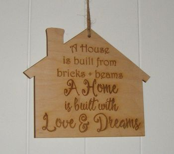 A house is built wooden plaque