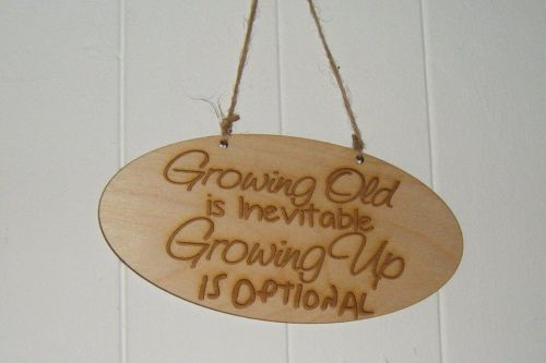 Growing old growing up wooden plaque