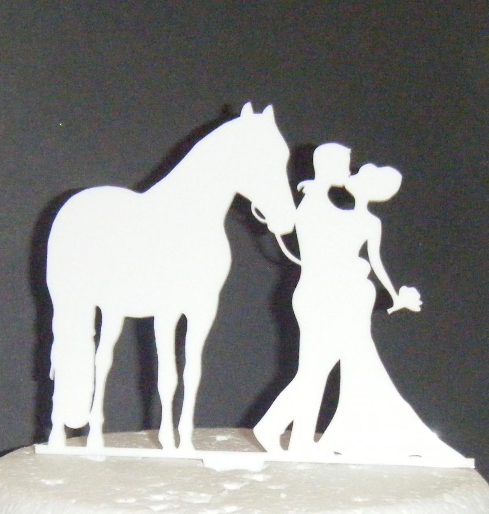 Wedding couple with a Horse Silhouette Cake Topper