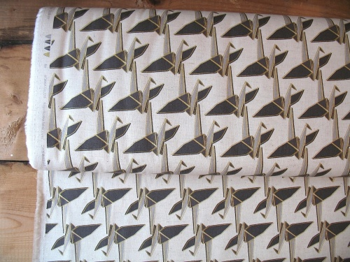 Ellen Luckett Baker Monochrome paper cranes in natural and gold