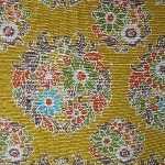 Cosmo Japan flower medallions on a mustard heavier weight canvas