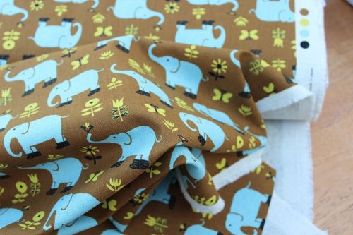 Hippy elephants on a retro chocolate linen mix