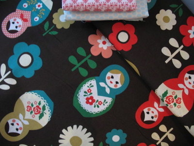 Kokka Dotty Russian dolls with blooms on brown