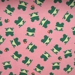 Kokka smiley frogs in heavy cotton on pink