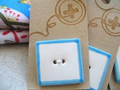 Handmade ceramic button square simple white with blue trim