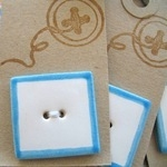 Handmade ceramic button square simple white with blue trim